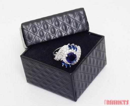 Luxe multi-zirkonen 18K witgouden ring met blauw zirkoon