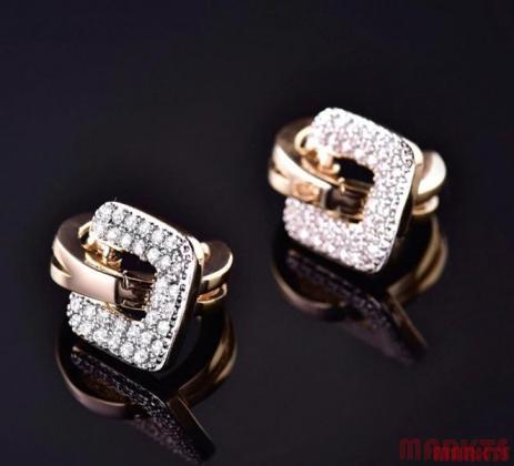 Moderne 18K gouden en 18K witgouden oorbellen met zirkonen
